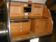 American Teardrop Trailers - pull-out stove, big drawers and a wooden ice box on the right