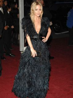 Feather gown by Lily et Cie and Azzedine Alaïa belt