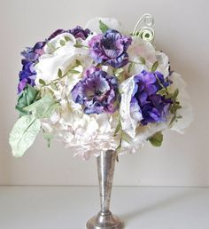 The purple really pops in this amazing bouquet, completely made from fabric and paper blooms!