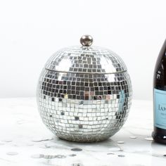 Bring studio 54 right into your own home with our disco ball ice bucket. Glass tiles catch the light and the eye of every guest at the party. It comfortably chills a bottle of your favorite bubbly or cabernet. Christmas Bath Bombs, Lucite Tray, Hanging Stars, Studio 54, Ball Lights, Gifts For Wine Lovers, Disco Ball, Glitz And Glam, Gift Store