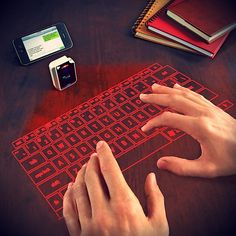 Virtual Keyboard From Brookstone / Tired of using your thumbs on minuscule smart phone and tablet keyboards? Spilled hot beverages and sticky stuff on a laptop keyboard? Forget all the keyboard pain with this virtual keyboard from Brookstone. Latest Gadgets, Gadgets And Gizmos, Tech Gadgets, Office Gadgets, Electronics Gadgets, Iphone Gadgets, Travel Gadgets, Cooking Gadgets, Cooking Tools