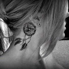 Dream Catcher tattoo behind ear.
