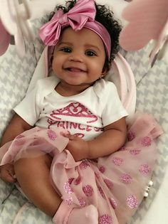 Adorable baby girl wearing pink bow. Princess t-shirt, tulle skirt.
