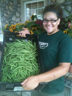 Miranda showing off our wonderful green beans :)