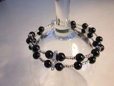 black onyx and silver seed bead bracelet with slide tube clasp
