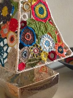 the fiber lounge - crochet lampshade. freeform crochet motifs put together on the frame of an old lamp shade. Used mostly leftover silk threads from needlepoint project (yarns lamp shades)the fiber lounge - crochet lampshade. This is a cool idea - co Lampe Crochet, Crochet Lampshade, Freeform Crochet, Crochet Art, Crochet Home, Irish Crochet, Crochet Motif, Free Crochet, Crochet Patterns