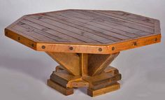 Reclaimed barn wood is used in this octagon rustic coffee table design. Solid salvaged beams are shaped for the base and barnwood planks are used for the top.