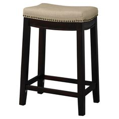 Stool in dark walnut with a linen-upholstered seat and nailhead trim.  Product: StoolConstruction Material: Hard...