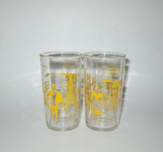 Vintage 1950s Drinking Glasses / 50s Eiffel Tower Drinking Glasses / 50s Clear Paris Novelty Glasses With Yellow Graphics by SayItWithVintage on Etsy