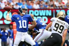 Giants vs. Saints:   September 18, 2016  -   By NEWSDAY.COM  sports@newsday.com   -    The Giants edged the New Orleans Saints, 16-13, in a Week 2 NFL game on Sunday, Sept. 18, 2016 at MetLife Stadium.  -    Eli Manning of the New York Giants looks to pass against the New Orleans Saints at MetLife Stadium on Sept 18. 2016, in East Rutherford, N.J.
