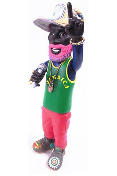 The Lee Scratch Perry vinyl figure is a Japanese import from PRESSPOP and is limited to 1000 units. Officially approved by Lee a.k.a. The Upsetter: the father of reggae and dub music. Designed by Sofboy comic creator, Archer Prewitt, this figure of Lee 'Scratch' Perry has adjustable arms and head and comes with accessories such as cloth hat, gold bracelet, and gold necklace with star charm. The figure also boasts details such as lighter being held in hand with microphone, wild hair, shoes…