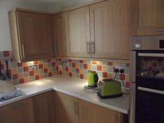 This shows tiling detail and under cabinet lighting. http://www.ppmsltd.co.uk