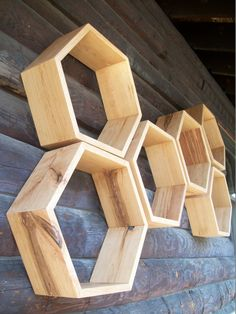 Gorgeous! Also come in pine and custom sizes to get the price down. Could see doing a set of these by each kids' bed as a floating bedside table, painted inside in fun colors. And possibly also a set downstairs... Custom Hardwood Hexagon Shelves SOLD by EONeyeofnature on Etsy