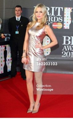 Gorgeous #LauraWhitmore in a metallic #ZoeJordanstudio dress and a #monicavinader cuff at the 2013 #BritAwards