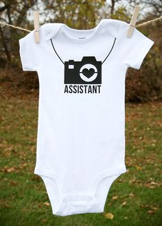 This assistant onesie is perfect for all you avid photographer mommies or a one-of-a-kind baby shower gift for a friend who loves photography!