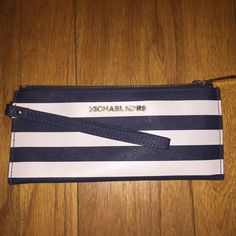 Authentic Michael Kors Wristlet! Host Pick 5/12!! Beautiful Striped Michael Kors Wristlet!! Bought Directly from Michael Kors store! Amazing  Condition! Great material/ Easy to Clean! •50% off original price!!!• I will not go any lower than 50! Michael Kors Bags Clutches & Wristlets