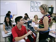 Zach Kasee, 13, talks to math teacher Carol Bell at the Toledo School for the Arts. Upgrades at the school put middle-school students on a on a separate floor from high-school students.  (Toledo Blade, September 2008)