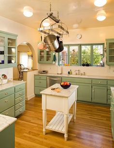 clean, not fussy green & cream country kitchen in 1928 Spanish colonial style house owned by Linda Ronstadt