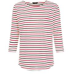 Work stripes in this 3/4 sleeve top - great paired with ripped knee skinny jeans and block heel ankle boots for daytime styles.