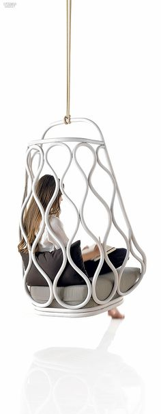 Mut Design's Nautica swing chair in rattan with foam and polyester-fiber cushion with waterproof and bioproof coating, covered in mass-dyed acrylic outdoor fiber by Expormim
