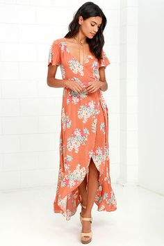 You'll be flourishing with style and grace once you slip into the Always in Bloom Burnt Orange Floral Print High-Low Wrap Dress! Mint blue, red, burnt orange, and cream floral print covers fluttering short sleeves and a wrapping bodice with waist tie. Breezy woven fabric cascades into a high-low skirt.