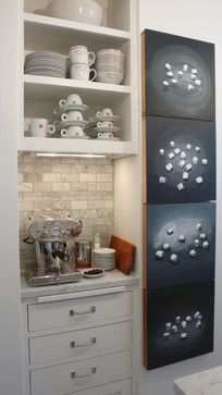 Where to Put Your Coffee Station?Choose the location for your coffee center wisely. If it's a full breakfast center, it should be out of the way of cleanup and cooking zones, but still close to the refrigerator. Position a bar area in between your kitchen and dining area. A butler's pantry would also be a convenient location for this work zone.