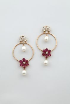 Ruby, Diamond and Pearl earrings set in 18K gold.