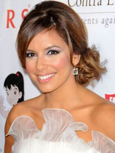 Side chignon. I totally want this for prom...except other side. :) but i rly like this hairstyle!!