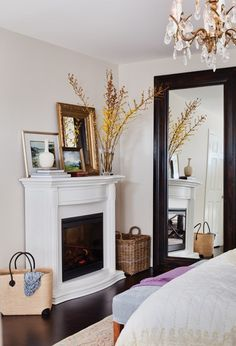 Dark Wood Floors, The White Fireplace, The Baskets, The Mirror, Etc. In The  Bedroom