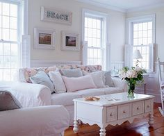 Lovely Linen There's nothing more inviting than soft, white linen slipcovers and quilt draped casually over a sofa back. Rapisardi added plenty of pillows in pastel pink, green, and blue to keep the palette alive in the living room.