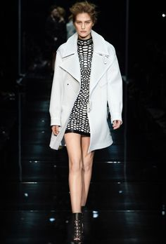 Tom Ford SS14 - Look 9 | Chalk nabuk bonded to neoprene messenger coat.  Black and chalk embroidered snake on super soft plonge fitted mini dress.  Black nappa stretch ankle-strap lace up sandal booties.