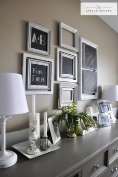 This is what i want for gabbis wall. I want all the walls grey with accents on the back wall of deep purple, teal and white picture frames. All the glass on the picture fames will be painted with chalkboard paint. White Picture Frames, Picture Ledge, Small Master Bedroom, Master Suite, Large Beds, Framed Chalkboard, French Country Cottage, Wall Decor, Bedroom Decor
