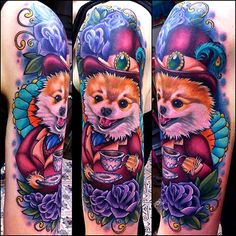 Gorgeous colours, love the puppy. Love the purple flowers and the vivid aqua.  Don't think I would have this on my body but maybe the parts I like.  Tattoo done byMegan Massacre.