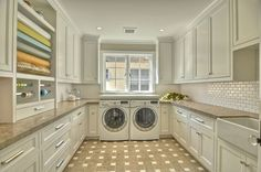 Are you freaking kidding me!!!?? I absolutely looooove this laundry room. I would just hang out in here.