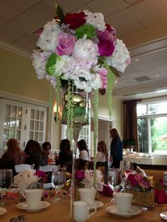 50th birthday luncheon floral arrangements filled with peonies, garden roses, freedom roses, orchids