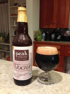 Peak Oak-aged Mocha Stout:  Day 132: Peak Oak-aged Mocha Stout from Peak Organic Brewing Company. Style of beer is 'Imperial Stout'. ABV is 8.4%.   Read more at http://www.beerinfinity.com/beer-of-the-day-peak-oak-aged-mocha-stout/.