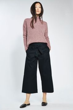 Celebrate the trousers shape of the season in this cool navy blue wide-leg style in poplin fabric. Cut in an 'awkward' length above the ankles, they come with a tie-waist and hidden side zip. Team with a funnel neck knit for a casual-cool look. #Topshop