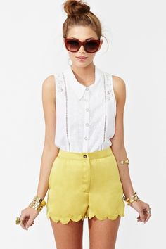 Yellow cut out shorts and white top.