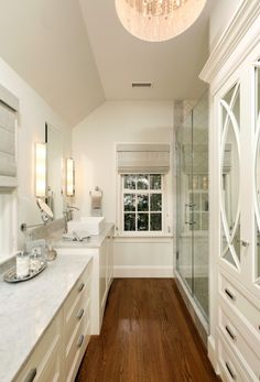 LOVE DRUM SHADE WITH CRYSTAL'S .DON'T LIKE SINK NOR DO I WANT WINDOWS IN MY BATHROOM UNLESS I'M ON 25TH FLOOR OF A CONDO BECAUSE OTHERWISE I'LL JUST KEEP THEM SHUT SO A WASTE  LOVE WALK IN GLASS DOOR SHOWER'S I NEVER USE A BATHTUB SO THAT WOULD BE A WASTE OF SPACE FOR  ME WHICH THIS BATHROOM DOESN'T HAVE ☺ I LOVE THE MOSTLY  WHITE & LOOKS LIKE MARBLE ON COUNTER AREA  ALSO NOT LIKING FIXTURES LIKE HANDLE'S ON CABINETS ETC.