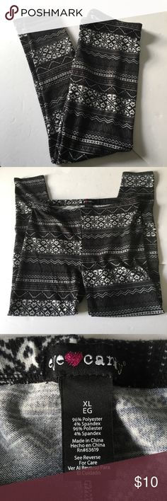Cute Winter Leggings Size XL  Black White This listing is for a pair of black and white holiday leggings by Eye Candy. They are size XL and have a fair isle/snowflake design. Eye Candy Pants Leggings