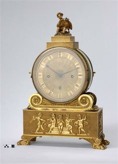 *Ornate cherub table clock with animal style feet, Stutzuhr  Goetz, Peter (maker)  Vienna, Austria- circa, 1820