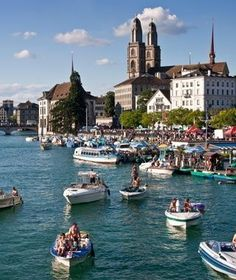 Lake Zürich with Fraumünster Church in the background, Zurich, Switzerland. The Fraumünster Church in Zurich is built on the remains of a former abbey for aristocratic women which was founded in 853 by Louis the German for his daughter Hildegard. Places Around The World, The Places Youll Go, Places To See, Around The Worlds, Switzerland Cities, Switzerland Vacation, Switzerland Summer, Lugano, Beaux Villages