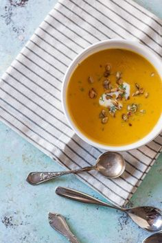 Roasted Heirloom Squash and Tart Apple Soup. A sweet and tart and savory fall soup with red kuri squash and tart apples topped with caramelized pepitas. Gluten free, vegetarian-friendly. From Blossom to Stem   Because Delicious   www.blossomtostem.net