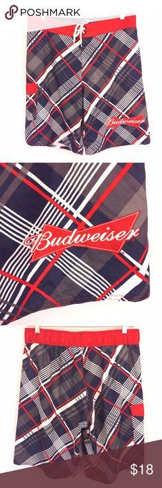 "Budweiser Board Shorts Sz 36 Red White Blue * Red, white & blue plaid swim trunks by Budweiser ; size 36  * Side pocket; lace up waist;  unlined  * Please refer to chart below for exact flat measurements and photos for item details  Waist: 18"" Inseam: 11"" Overall length: 22"" Item Number: J55 E Budweiser Swim Board Shorts"