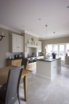 The lightness of it all. Particularly keen on the floors, hanging lights, and white cabinets