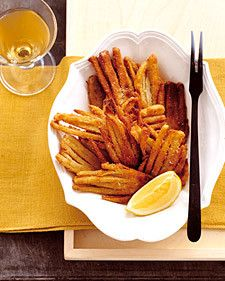 Slices of fennel are coated in egg and bread crumbs, and fried to a crisp golden-brown. Serve the fried fennel hot with lemon wedges.