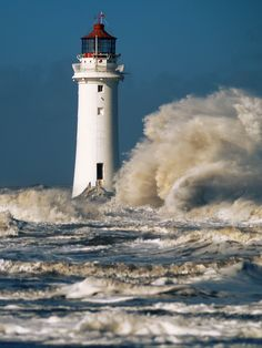Iconic Liverpool's River Mersey Perch Rock Lighthouse at New Brighton on the Wirral during spring storms.