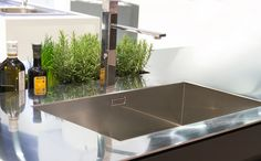 Integrated, thin, stainless steel countertop and sink say #modern #kitchen