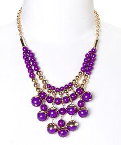 Love this Gold & Purple Round Bead Bib Necklace by C.O. International on #zulily! #zulilyfinds