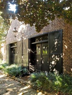The Sword Gate House in Charleston - Brick, black trim, doors, plants. Exterior Design, Interior And Exterior, Cheap Garage Doors, Gate House, Expensive Houses, Carriage House, Carriage Doors, Home Fashion, My Dream Home